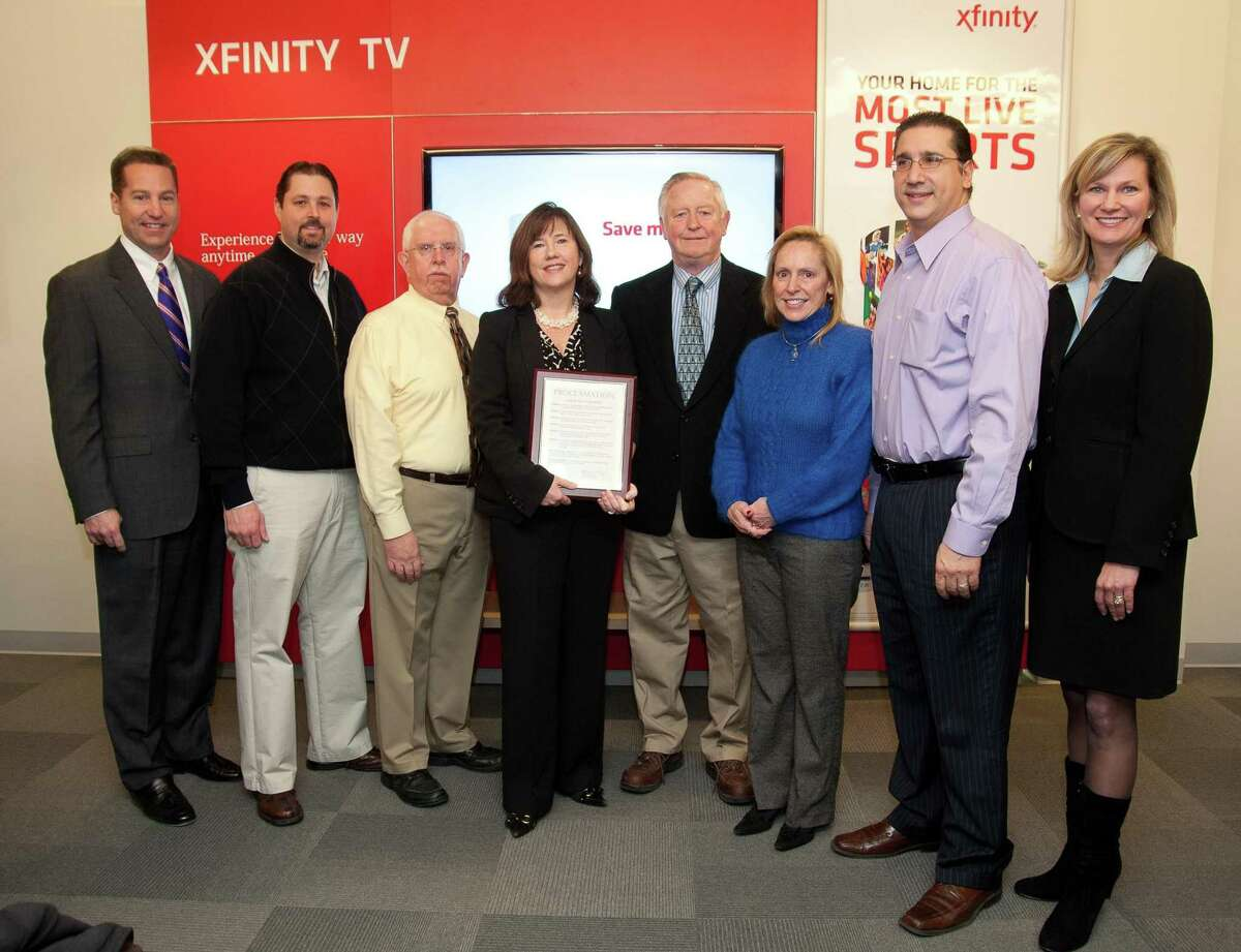 Submitted photo In celebration of Comcast opening its first Xfinity Customer Service Center in Connecticut, Deputy First Selectman Dick Newton (center) presented a Proclamation proclaiming Jan. 19 as