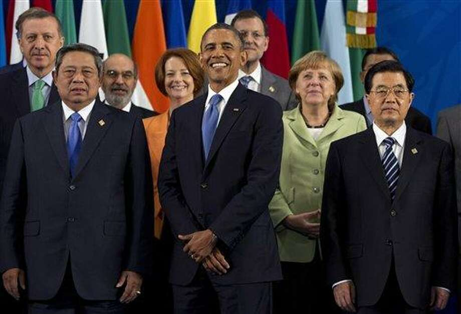 President Barack Obama takes his place with other leaders for the Family Photo during the G20 Summit Monday in Los Cabos, Mexico. From left, Turkish Prime Minister Recep Tayyip Erdogan; Indonesian President Susilo Bambang Yudhoyono; Jose Graziano da Silva; Australian Prime Minister Julia Gillard; Obama; Spanish Prime Minister Mariano Rajoy; German Chancellor Angela Merkel; Chinese President Hu Jintao. Associated Press Photo: AP / AP