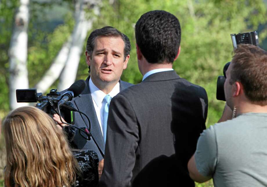 U.S. Sen Ted Cruz, R-Texas, talks with reporters as he arrives to a state Republican fund-raiser Friday, Aug. 23, 2013 in Dublin, N.H. The freshman senator has made national headlines suggesting that Republicans in Congress shut down the federal government to stop implementation of President Barack Obama's signature health care overhaul, the Affordable Care Act.(AP Photo/Jim Cole) Photo: AP / AP