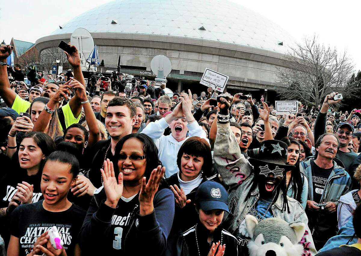 Jessica Hill — The Associated Press Fans cheer outside Gampel Pavilion during a rally honoring the women's basketball team's national championship in April.