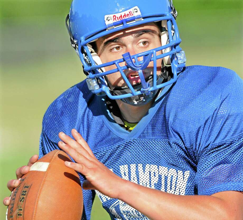 Bellhawk junior CJ Lemere fills in for injured quarterback Austin Mann Friday afternoon at practice. Photo: Catherine Avalone — The Middletown Press  / TheMiddletownPress