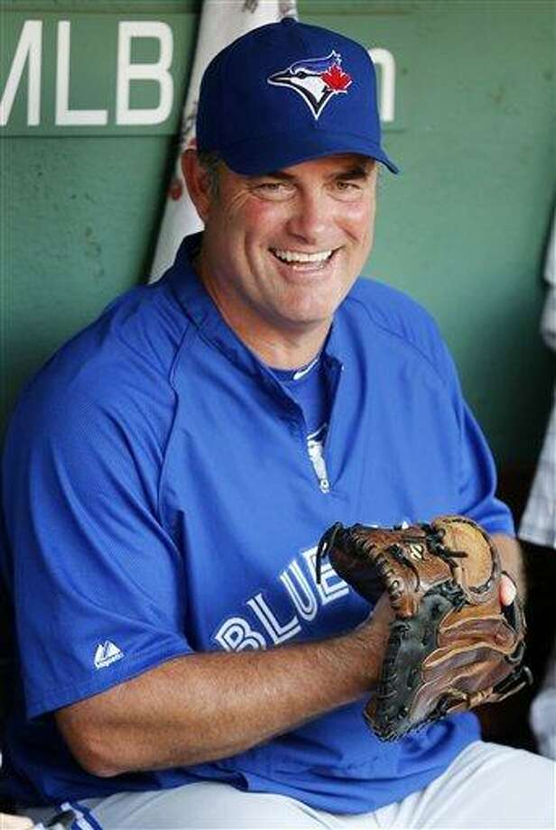 John Farrell sits in the dugout before the Toronto Blue Jays' baseball game against the Boston Red Sox in September. The Red Sox have reached an agreement to bring Farrell to Boston to replace Bobby Valentine. AP Photo/Michael Dwyer Photo: AP / AP