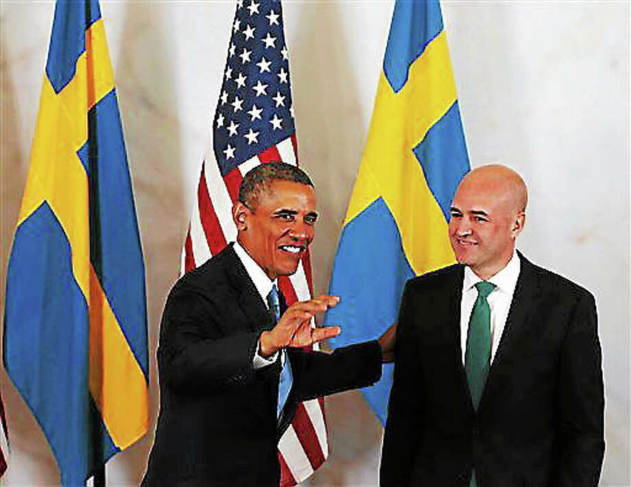 US President Barack Obama, left, reacts with Sweden's Prime Minister Fredrik Reinfeldt, at Rosenbad, the seat of the Swedish government in Stockholm, Sweden, Wednesday, Sept. 4, 2013. President Barack Obama is opening a three-day overseas trip with a stop in the Swedish capital of Stockholm, ahead of the G20 Summit, to be held in St. Petersburg, Russia.  (AP Photo/Frank Augstein) Photo: AP / AP