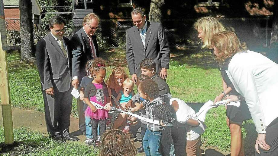 Preschool students from the Middlesex YMCA joined city and state officials along with a representative from Comcast to cut the ribbon for the Born Learning Trail at Macdonough Elementary School. Photo: Kaitlyn Schroyer - Middletown Press