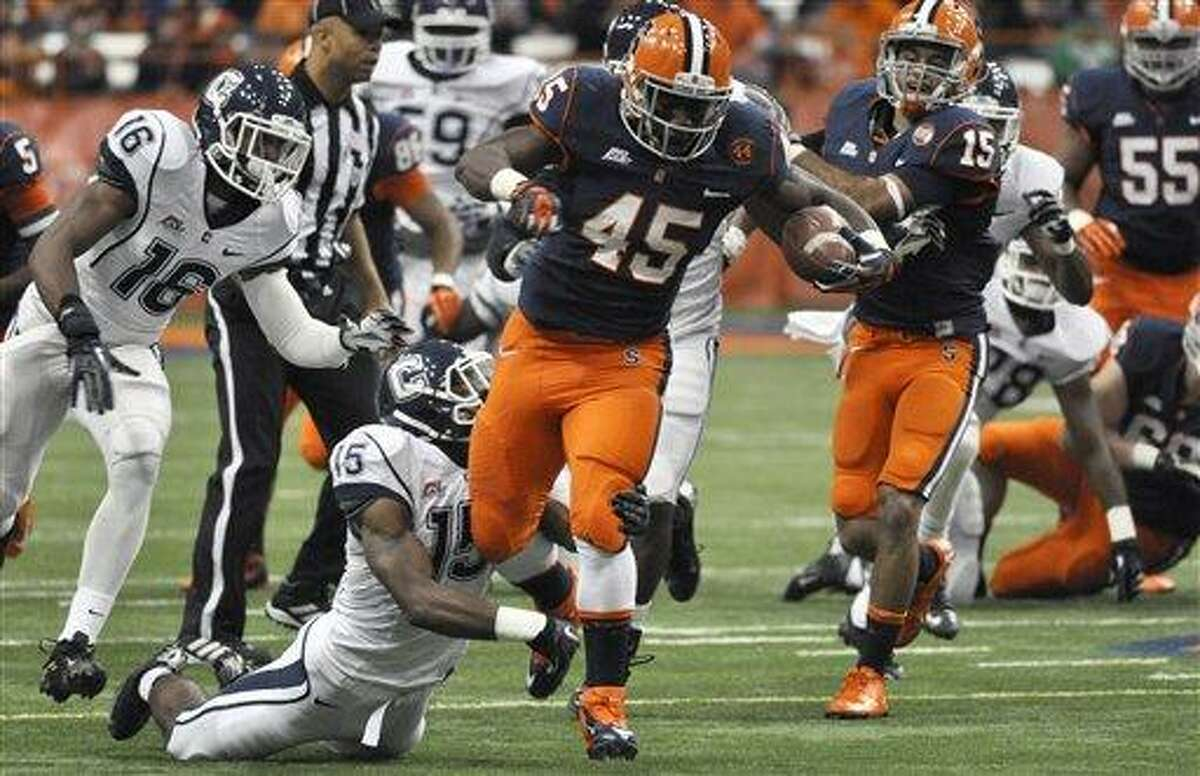 Syracuse running back Jerome Smith (45) tries to break free from Connecticut's Ty-Meer Brown during the first quarter of an NCAA college football game in Syracuse, N.Y., Friday, Oct. 19, 2012. (AP Photo/Kevin Rivoli)