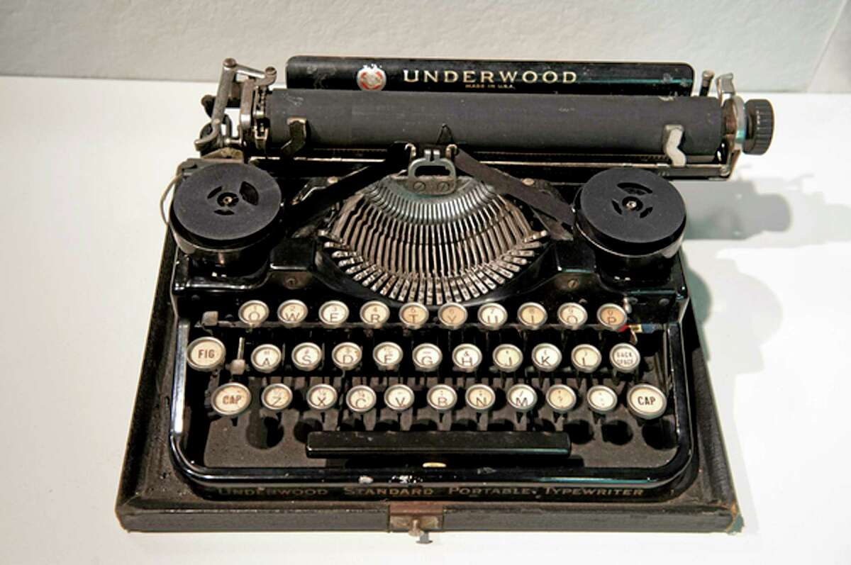 In this Aug. 22, 2013, photo provided by Northeastern University, Ernest Hemingway's 1929 Underwood Standard typewriter sits on display at in an exhibit called