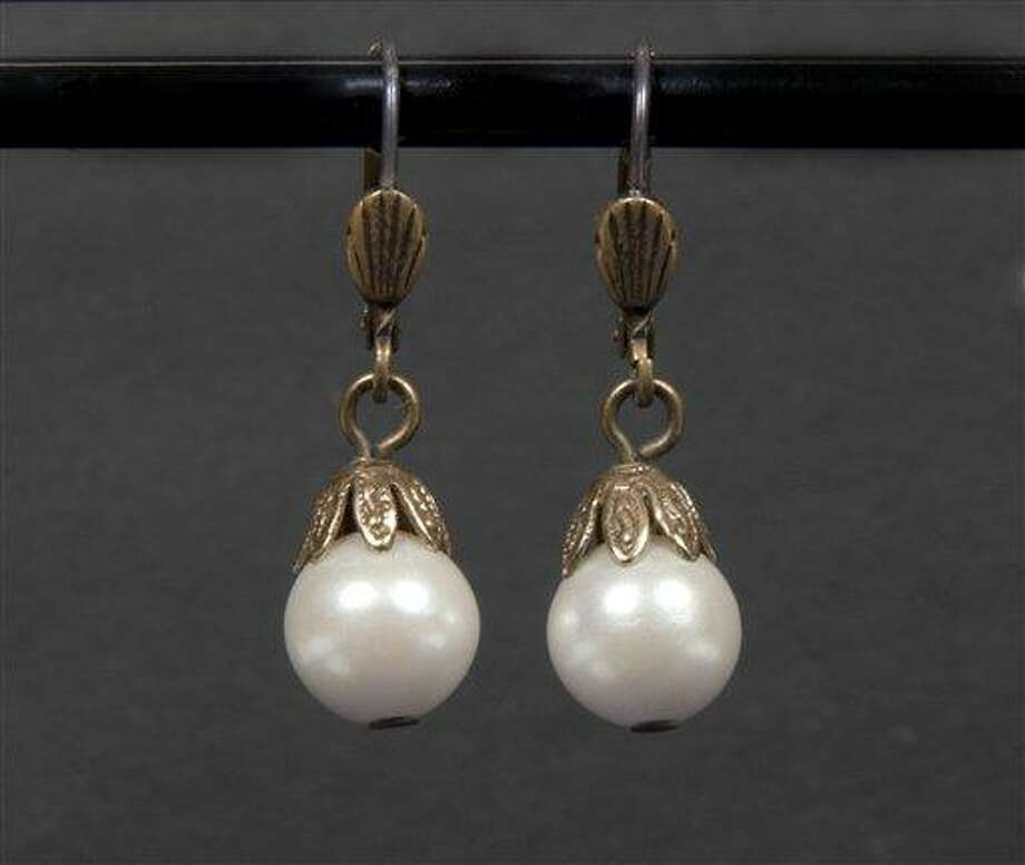 "This undated image released by Julien's Auctions shows a pair of pearl drop earrings worn by Whitney Houston in the movie ""The Bodyguard."" Associated Press Photo: AP / JULIENS AUCTIONS"