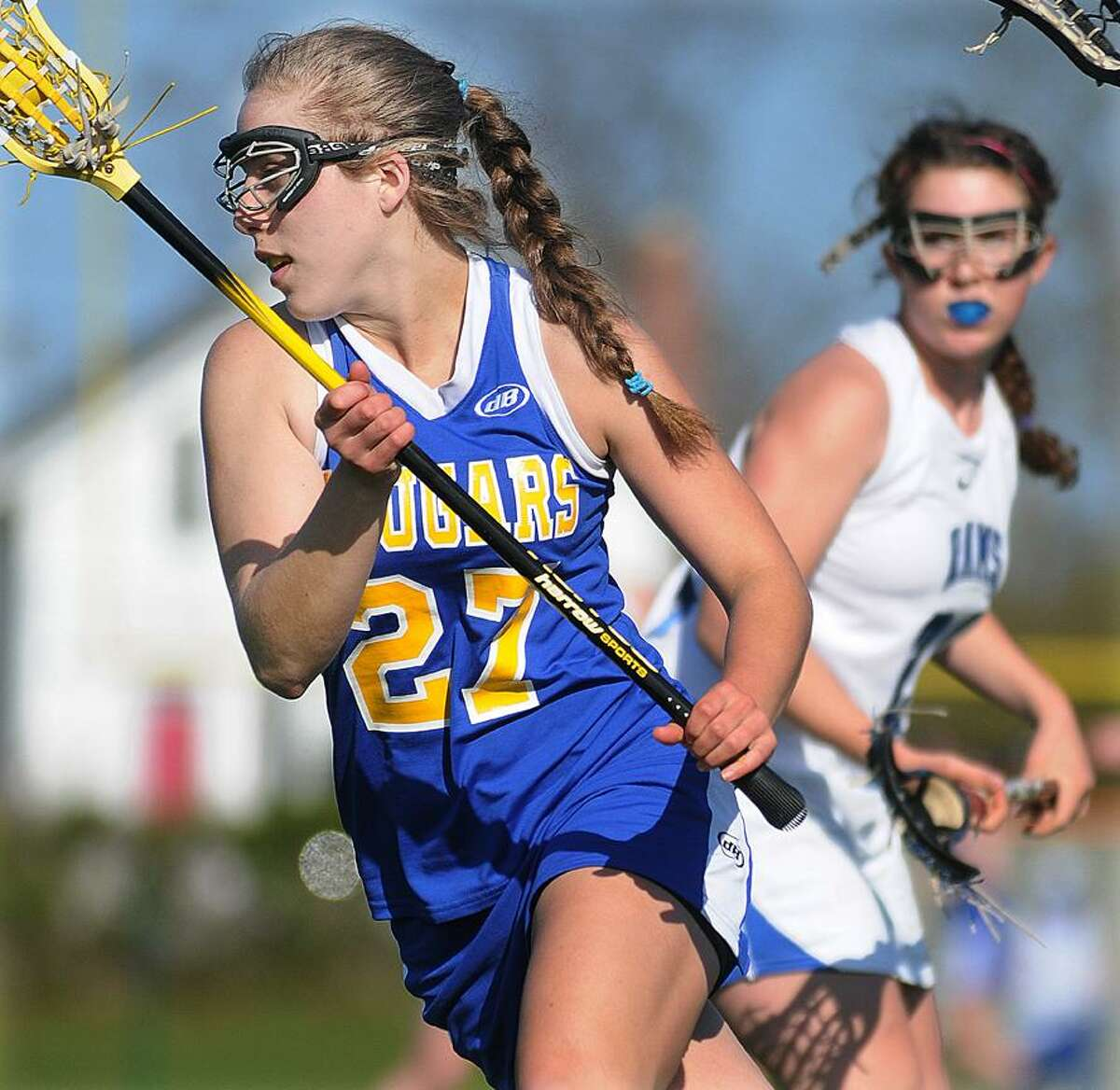 Catherine Avalone/The Middletown PressHaddam-Killingworth senior Kasey Jacobs moves the ball away from the Cougar goal as Old Saybrook freshman Kylie Cherry defends Thursday afternoon in Old Saybrook. H-K defeated Old Saybrook 17-9.