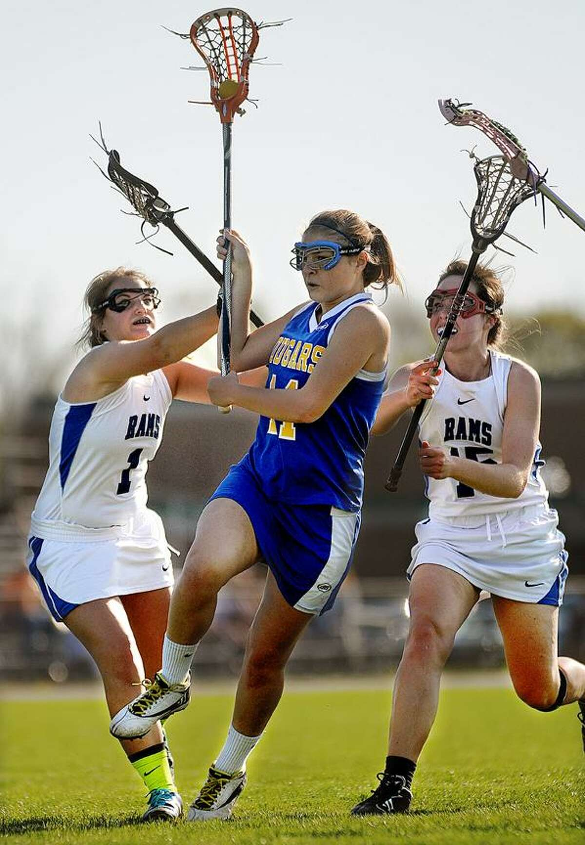 Catherine Avalone/The Middletown PressHaddam-Killingworth junior Susanne Pasqualini plows through Old Saybrook defenders Julia DePalermo (1) and Hudson Roarick (15) Thursday afternoon in Old Saybrook to score. H-K defeated Old Saybrook 17-9.