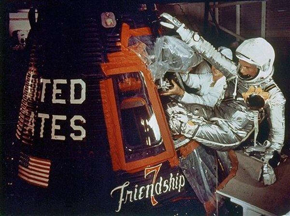 In this Feb. 20, 1962 file photo provided by NASA, astronaut John Glenn climbs into the Friendship 7 space capsule atop an Atlas rocket at Cape Canaveral, Fla., for the flight which made him the first American to orbit the earth. Associated Press