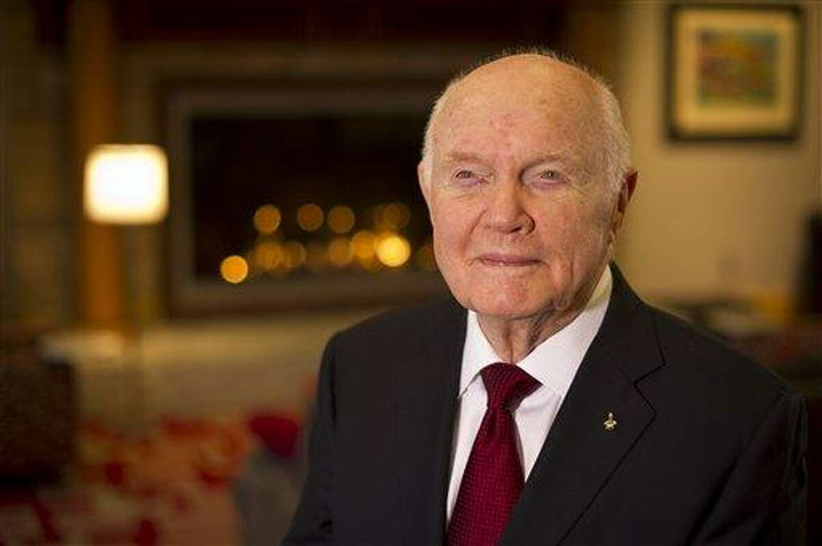 Sen. John Glenn poses for a portrait shortly after doing live television interviews from the Ohio State University Union building Monday in Columbus, Ohio. Monday marks the 50th anniversary of Glenn's historic flight. Glenn was the first American to orbit Earth. Associated Press/NASA, Bill Ingalls