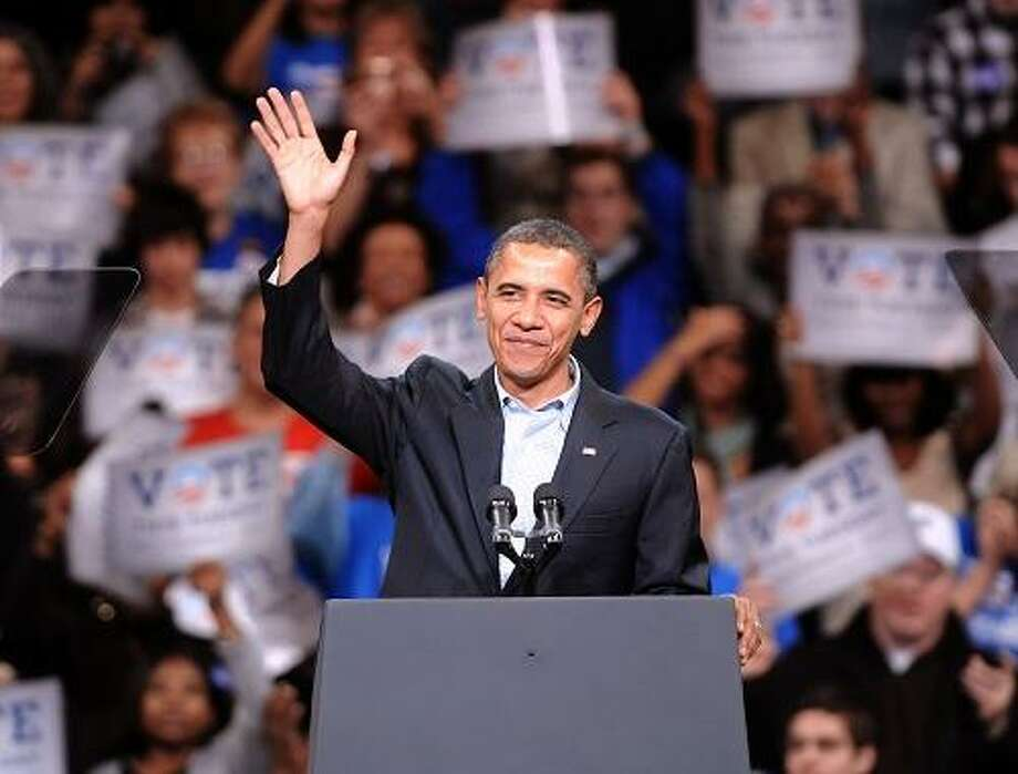 10/30/10 Bridgeport--President Barack Obama greets the crowd before speaking at a rally supporting Connecticut Democratic Candidates at Harbor Yard. Photo-Peter Casolino/New Haven Register