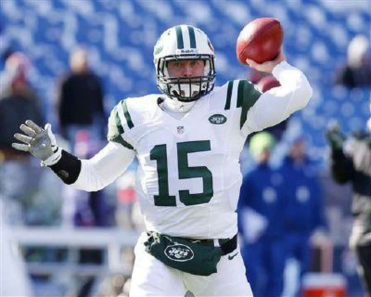 New York Jets quarterback Tim Tebow (15) warms up before of an NFL game against the Buffalo Bills, Dec. 30, 2012, in Orchard Park, N.Y.