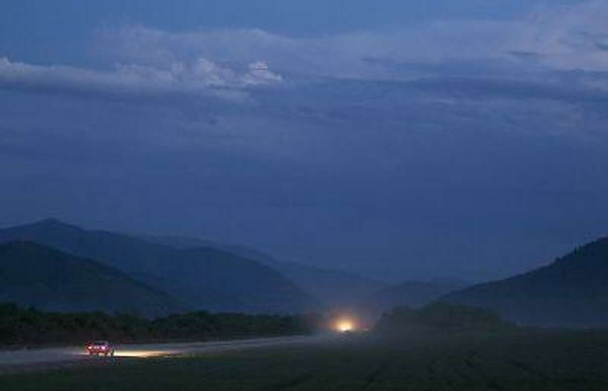 Cars drive along the road outside Chiri-Yurt, the village where the Tsarnaev family has it's roots, in Chechnya, Russia April 29, 2013. (Reuters/Maxim Shemetov)