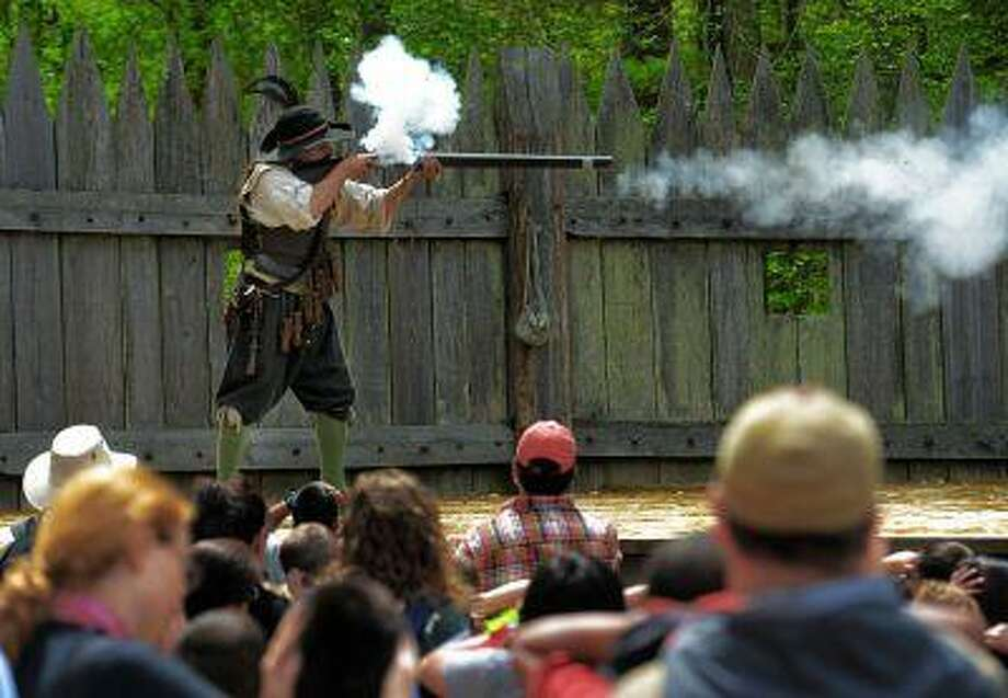 Tourists can view a musket demonstration during a visit to James Fort at Jamestown Settlement in Virginia. In 2007, Jamestown Settlement commemorated the 400th anniversary of the community's founding by enlarging and updating the state-operated museum, which originally opened in 1957 for the 350th milestone. Photo: The Washington Post / The Washington Post