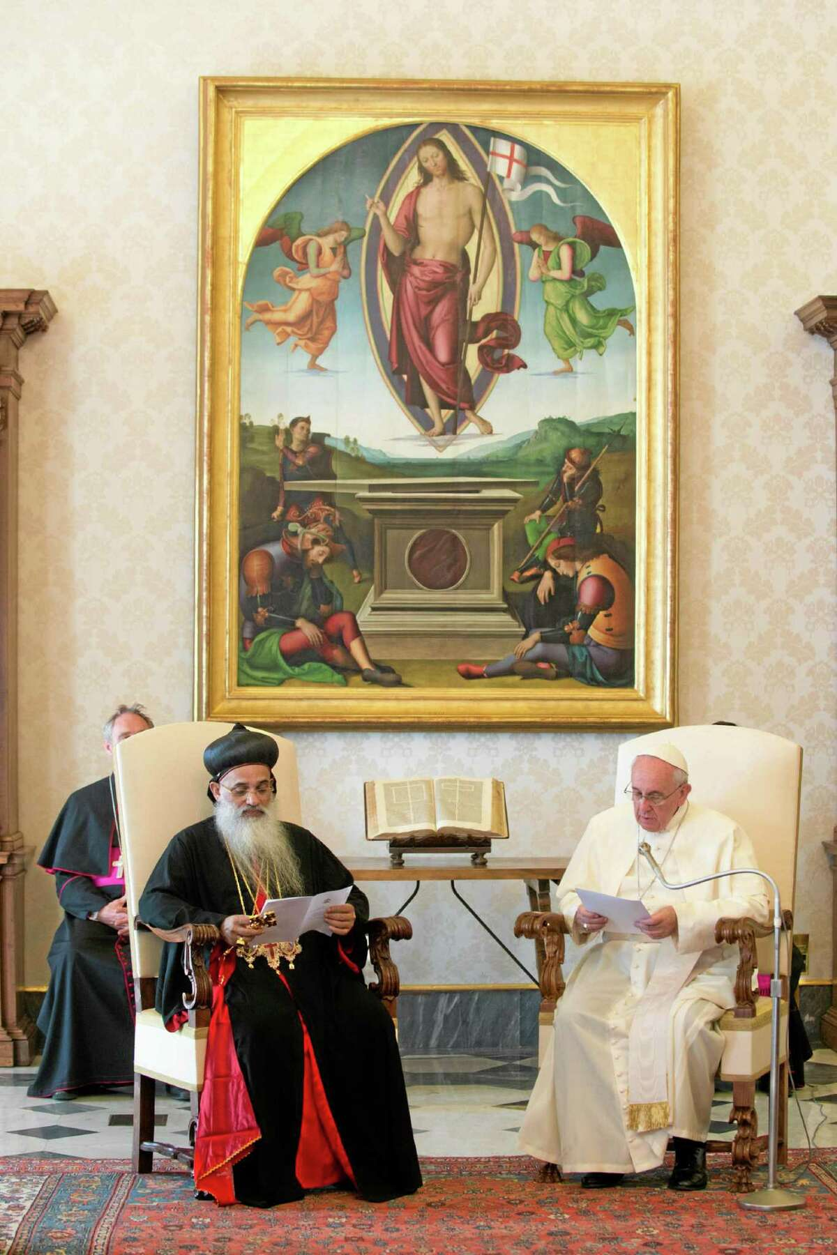 In this photo provided by the Vatican newspaper L'Osservatore Romano, Pope Francis, right, meets Moran Baselios Marthoma Paulose II, Catholicos of the Malankara Orthodox Syrian Church, India, during a private audience at the Vatican, Thursday, Sept. 5, 2013. (AP Photo/L'Osservatore Romano, ho)