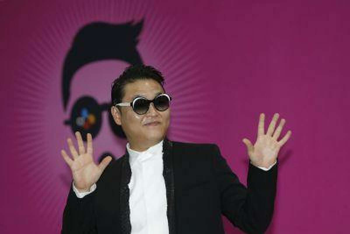 """South Korean rapper Psy poses during a news conference before his concert in Seoul April 13, 2013. Psy will perform """"Gentleman"""" in public for the first time on Saturday at a concert at Seoul's World Cup stadium but he has been coy about what dance to expect this time, except to hint that it is based on traditional Korean moves. Psy released his new single on Thursday hoping to repeat the success of """"Gangnam Style"""" that made him the biggest star to emerge from the growing K-pop music scene. REUTERS/Lee Jae-Won (SOUTH KOREA - Tags: ENTERTAINMENT)"""