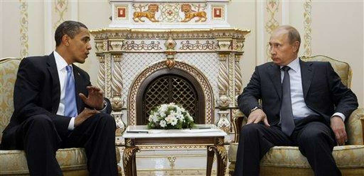 In this July 2009 file photo, President Barack Obama meets with then Russian Prime Minister Vladimir Putin in Moscow. President Barack Obama and Russian President Vladimir Putin will use their first meeting Monday since Putin returned to the top job to claim leverage on their twin needs: Obama needs Russia to help, or at least not hurt, U.S. foreign policy aims in the Mideast and Afghanistan. Putin needs the United States as a foil for his argument that Russia doesn't get its due as a great power. Associated Press