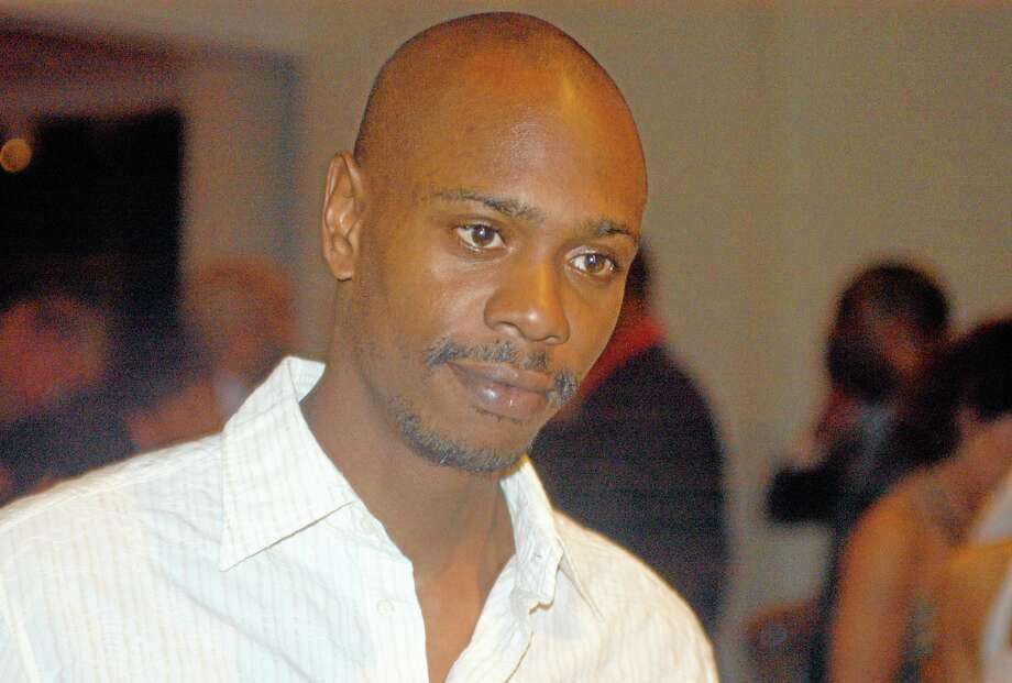 Inb a May 5, 2006 file photo comedian Dave Chappelle attends a reception at the Muhammad Ali Center in Louisville, Ky.  Chappelle decided to sit out most of his show in Hartford Thursday, Aiug. 29, 2013, because of a noisy audience. (AP Photo/Brian Bohannon, file) Photo: AP / AP
