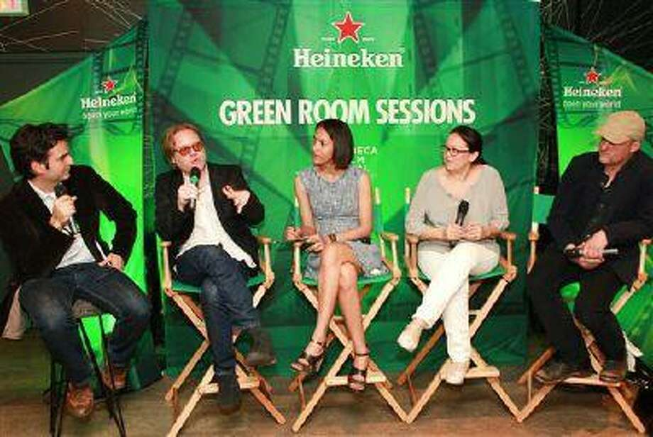 "New York Magazine Film Critic Bilge Ebiri, left, Director Alex Meillier,second from left, Ambassador Sofia Mesquita Borges, center, Producer Tanya Meillier, right center, and Cinematographer Shane Sigler discuss the film ""Alias Ruby Blade: A Story of Love and Revolution"" at Heineken Green Room Session during Tribeca Film Festival in New York. Photo: HEINEKEN VIA AP IMAGES / HEINEKEN"