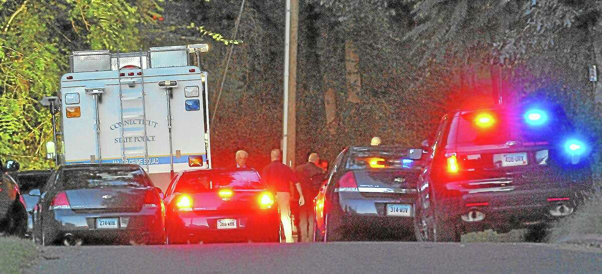 Emergency personel at the scene where a man was found near death on Riverview Street in Portland Thursday afternoon. Catherine Avalone - The Middletown Press