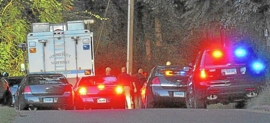 Emergency personel at the scene where a man was found near death on Riverview Street in Portland Thursday afternoon. Catherine Avalone - The Middletown Press Photo: Journal Register Co. / TheMiddletownPress