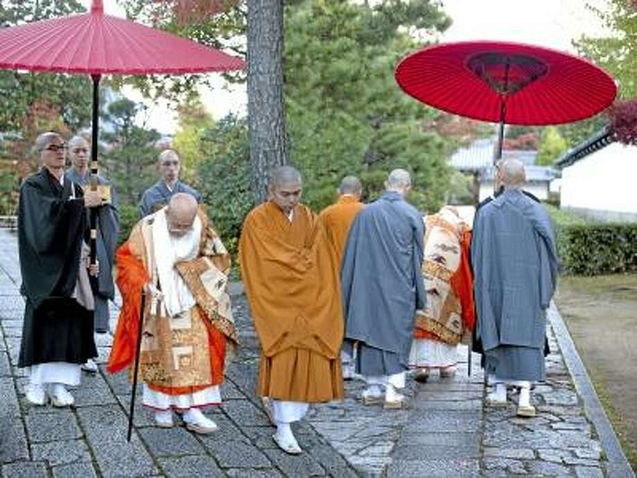 """Submitted photo  Photographer, filmmaker and architect Tom Rossiter will present a program of photographs from his travels and work called """"Standing Still Around the World"""" at the Essex Library on Friday, March 8, at 7 p.m. This picture taken in Japan at a religious ceremony is titled No Coming No Going."""