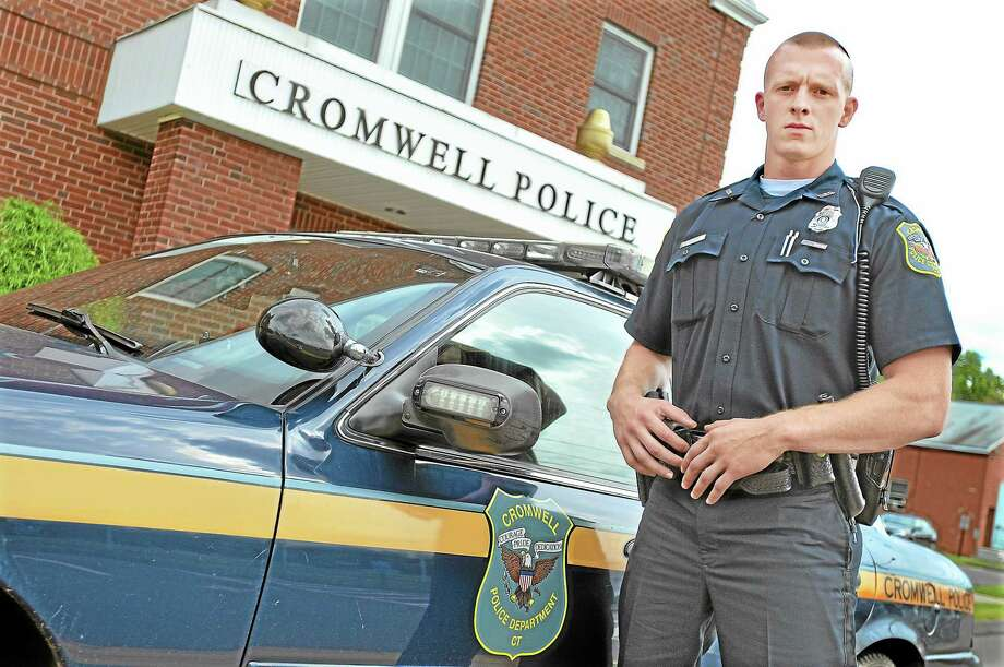 John Carlson, the newest officer at Cromwell Police Department holds a bachelor's degree in criminal justice from Springfield College in 2011 and a 2007 graduate of Cromwell High School. Catherine Avalone — The Middletown Press Photo: Journal Register Co. / TheMiddletownPress