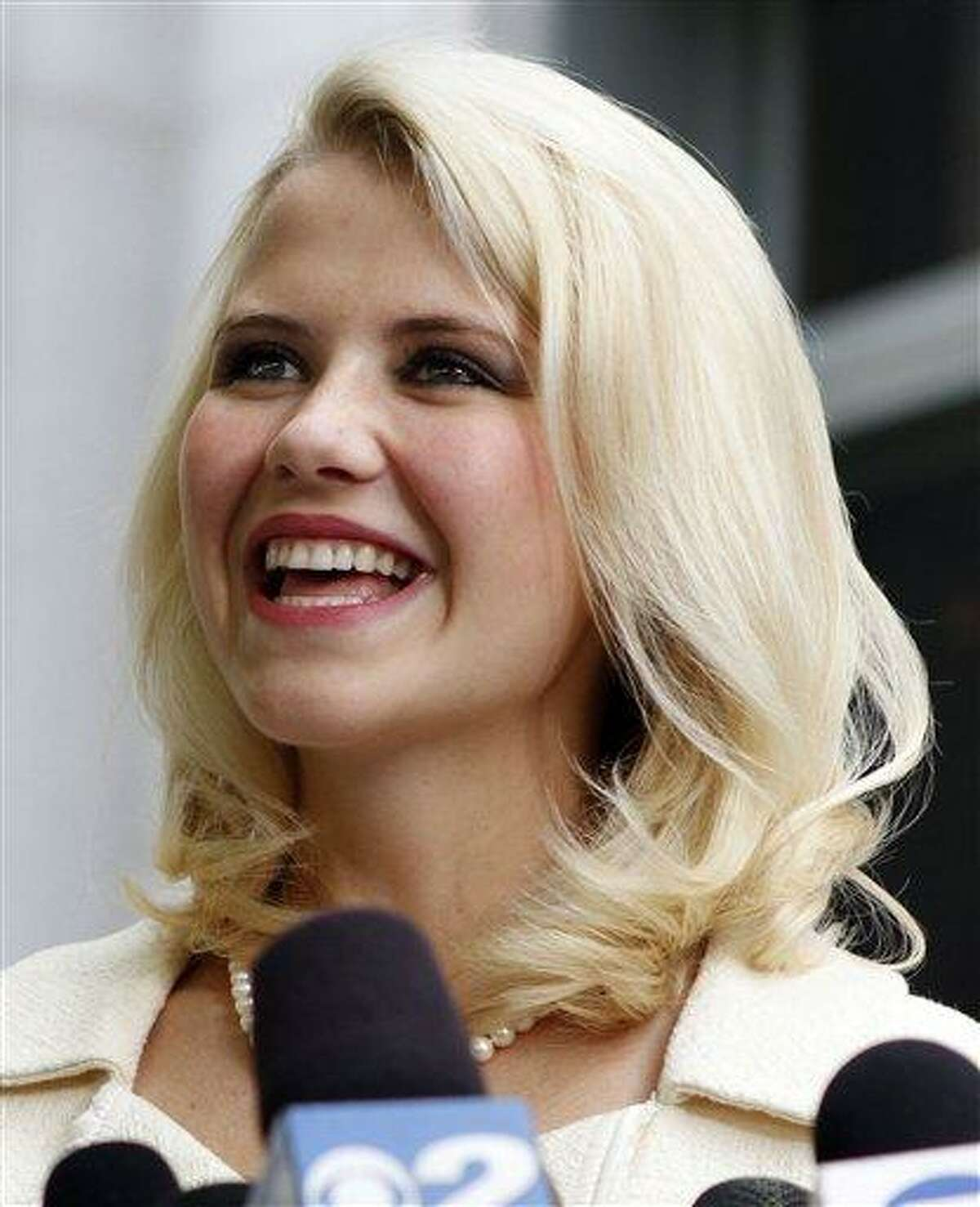 Elizabeth Smart talks to the media in May 2011 in front of the Frank E. Moss Federal Courthouse in Salt Lake City. A family spokesman says the Utah woman who was kidnapped at knifepoint at age 14 and held captive for nine months married Matthew Gilmour Saturday in Oahu. Smart, 24, is a senior at Brigham Young University. She met Gilmour, of Aberdeen, Scotland, while serving a Church of Jesus Christ of Latter-day Saints mission in France. Associated Press