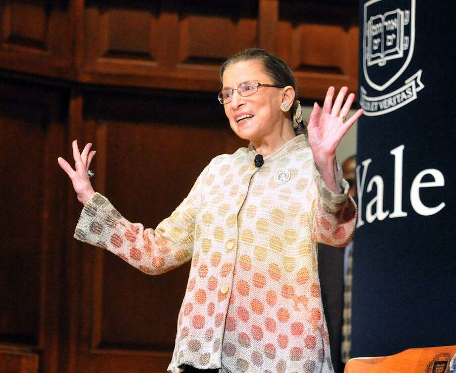 New Haven--Supreme Court Justice Ruth Bader Ginsburg tries to quiet applause from the crowd at Yale University's Battell Chapel.  Photo by Peter Casolino/New Haven Register 10/19/12