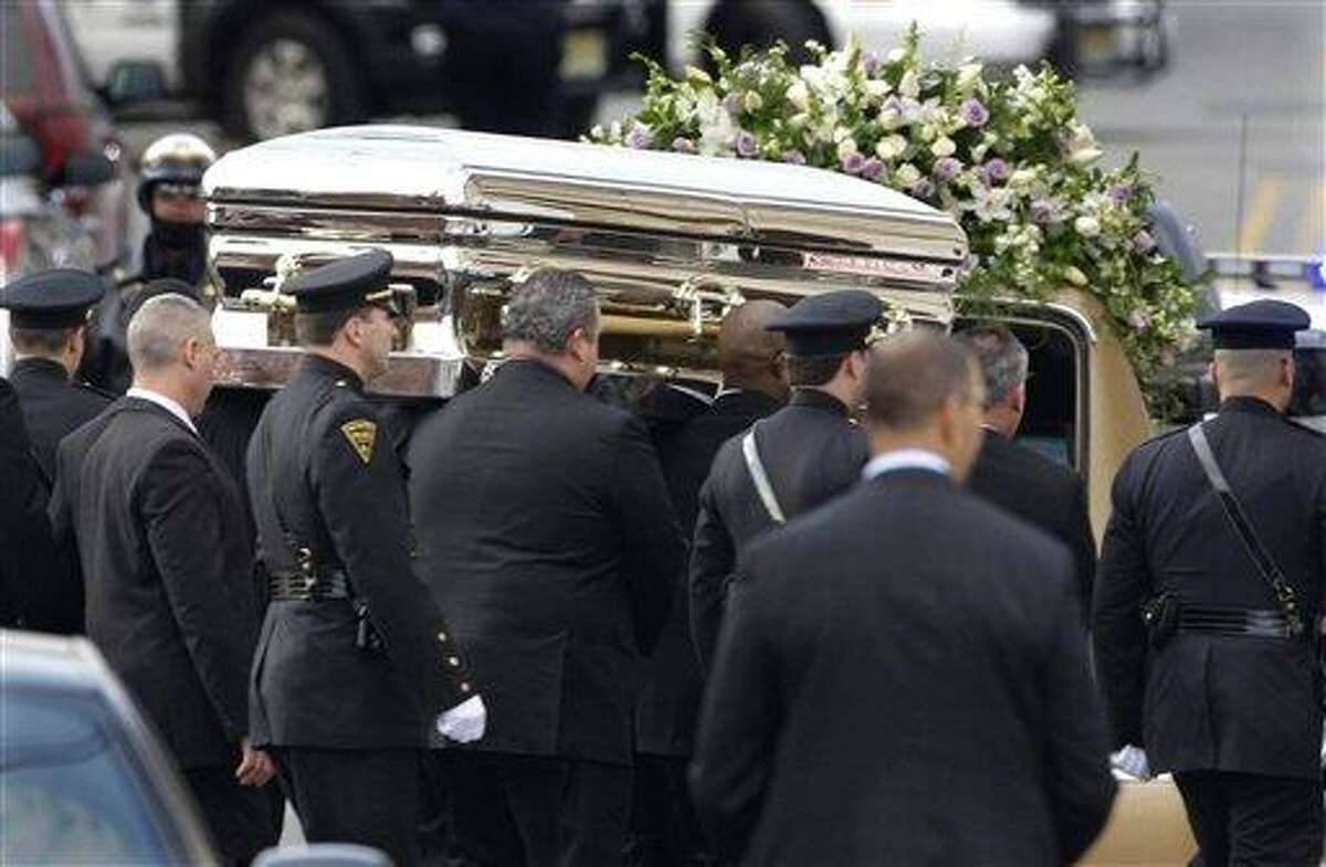The coffin holding the remains of singer Whitney Houston is carried to a hearse after funeral services at the New Hope Baptist Church in Newark, N.J., Saturday. Houston died last Saturday at the Beverly Hills Hilton in Beverly Hills, Calif., at the age 48. Associated Press