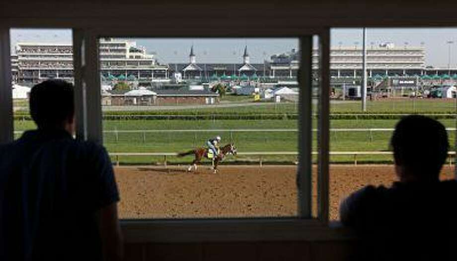 Exercise rider Emerson Chavez rides Kentucky Derby hopeful Golden Soul for a workout at Churchill Downs Wednesday, May 1, 2013, in Louisville, Ky. Photo: AP / AP
