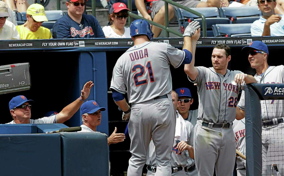 New York Mets' Lucas Duda (21) is congratulated by Daniel Murphy (28) after hitting a home run in the third inning of a baseball game against the Atlanta Braves Wednesday, Sept. 4, 2013, in Atlanta. (AP Photo/John Bazemore)