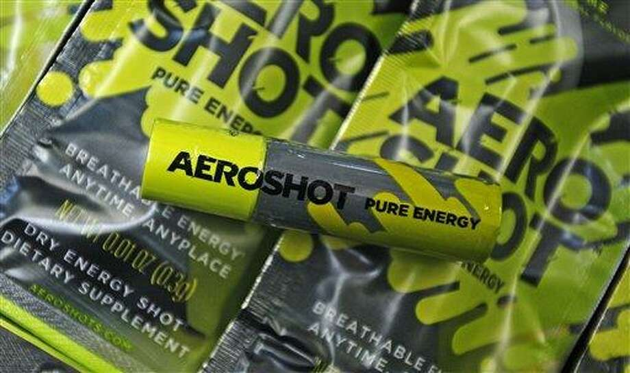 "An ""Aero Shot"" caffeine device is displayed in Boston, Feb. 7. The lipstick-sized product went on the market late last month in Massachusetts and New York, and is also available in France. A single unit costs $2.99 at convenience, mom-and-pop, liquor and online stores. Associated Press Photo: AP / AP"