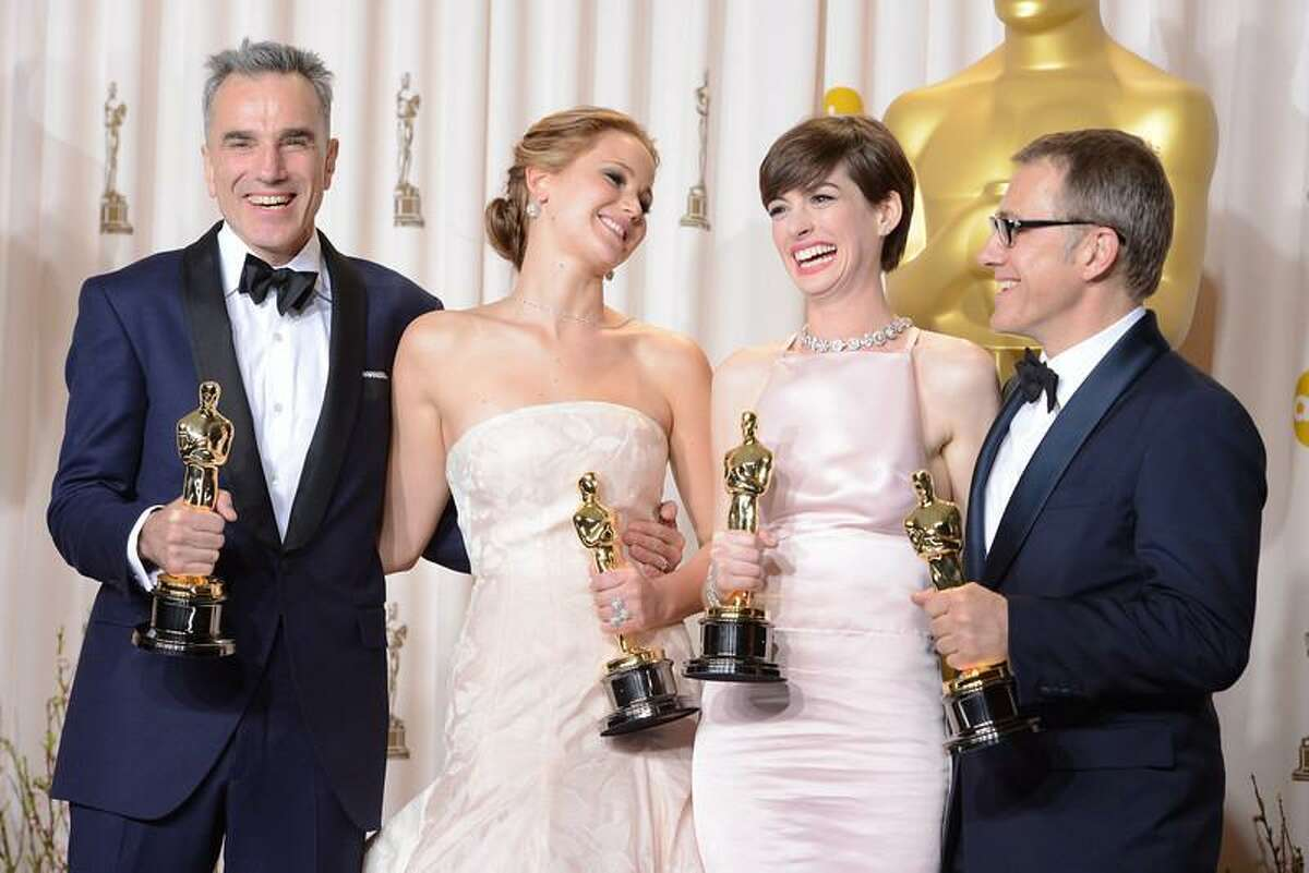 Oscar winners Daniel Day-Lewis, Jennifer Lawrence, Anne Hathaway and Christoph Waltz backstage at the 85th Academy Awards at the Dolby Theatre in Los Angeles, California on Sunday Feb. 24, 2013 ( David Crane, staff photographer)