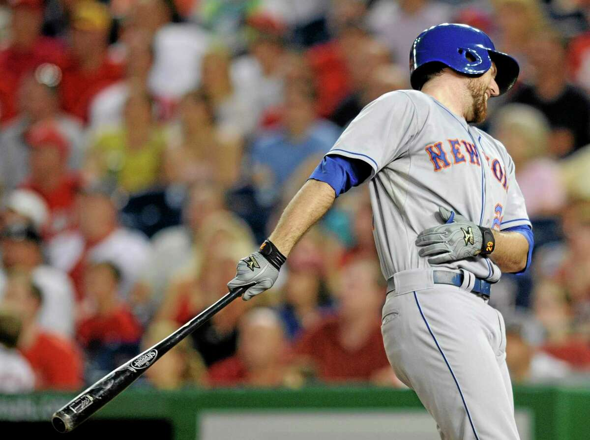 New York Mets' Ike Davis reacts after batting against the Washington Nationals during the third inning of a baseball game on Saturday, Aug. 31, 2013, in Washington. Davis left the game with an injury. (AP Photo/Nick Wass)