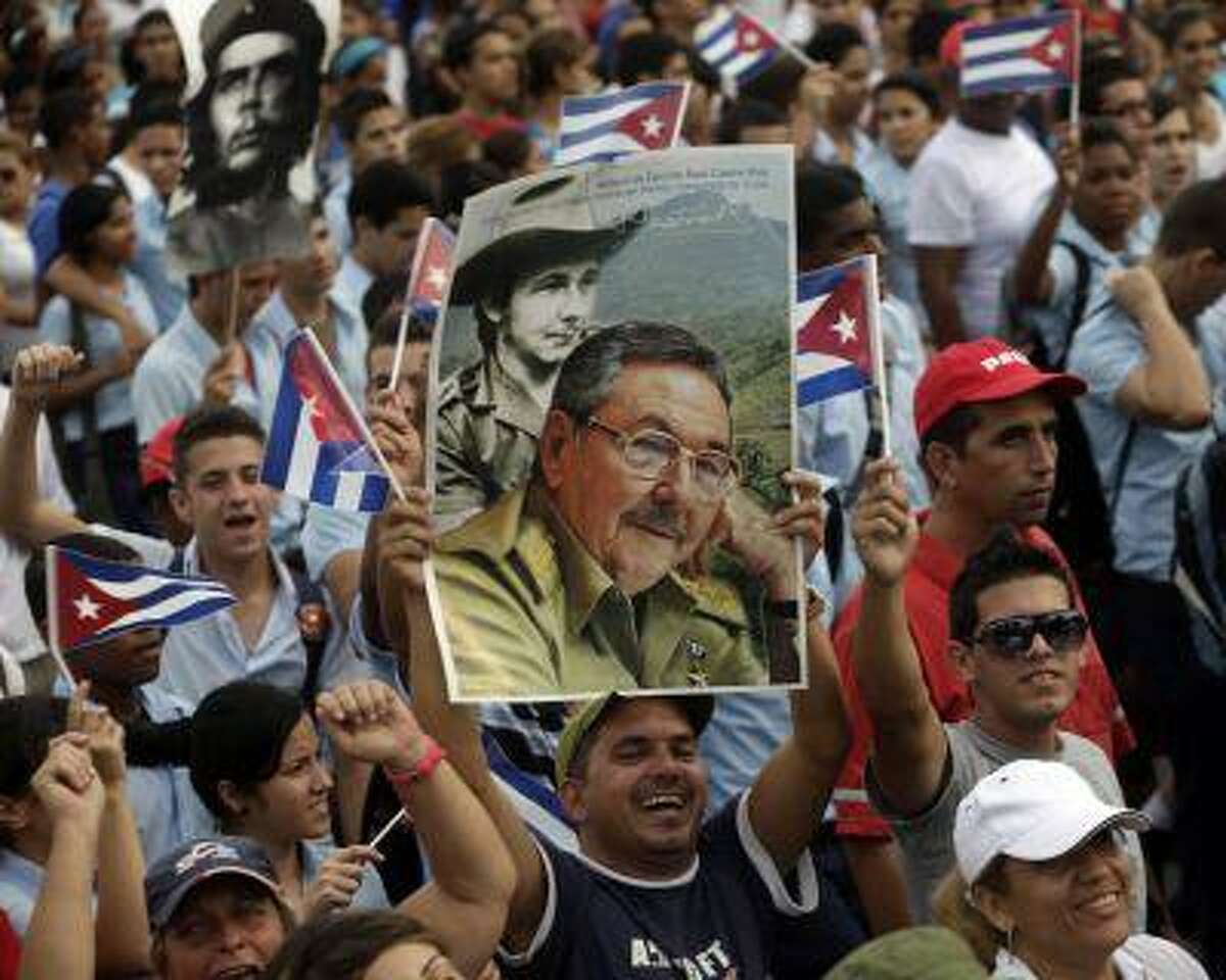 People carry an image of Cuba's president Raul Castro at the May Day parade in Havana's Revolution Square May 1, 2013. REUTERS/Enrique De La Osa (CUBA - Tags: POLITICS)