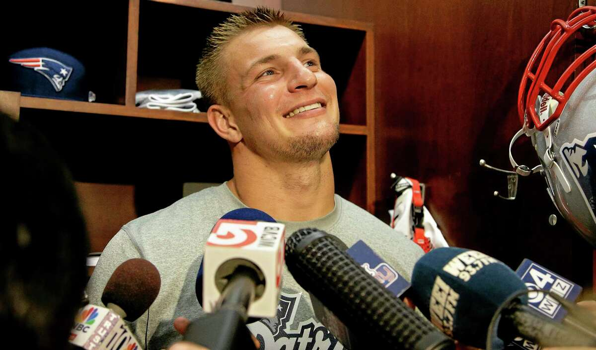 New England Patriots tight end Rob Gronkowski smiles as he talks about his return to the field during a media availability in front of his locker after practice at the NFL football team's facility in Foxborough, Mass., Wednesday Sept. 4, 2013. The Patriots open their regular season against the Buffalo Bills on Sunday. (AP Photo/Stephan Savoia)