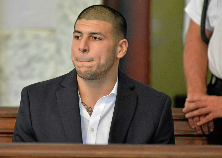 Former New England Patriot football player Aaron Hernandez, listens to procedings in a court in Attleboro, Mass., Thursday, Aug. 22, 2013. Hernandez was indicted on first-degree murder and weapons charges in the death of a friend whose bullet-riddled body was found in an industrial park about a mile from the ex-player's home. (AP Photo/Josh Reynolds) Photo: AP / FR25426 AP