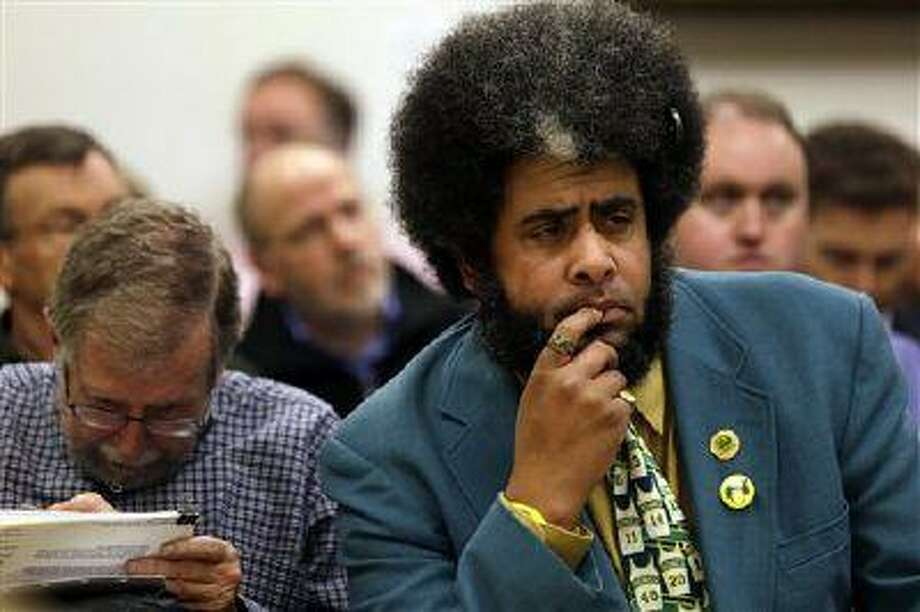 """Long-time Seattle SuperSonics fan Kris """"Sonics Guy"""" Brannon listen to arguments during a hearing related to the team in King County Superior Court, Feb. 22, 2013, in Seattle. Photo: AP / AP"""