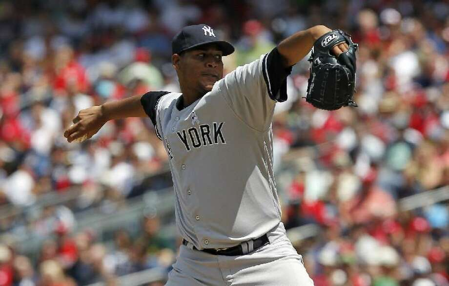 ASSOCIATED PRESS New York Yankees starting pitcher Ivan Nova throws during the second inning of Sunday's game against the Washington Nationals at Nationals Park in Washington. The Yankees won 4-1 to sweep the weekend series.