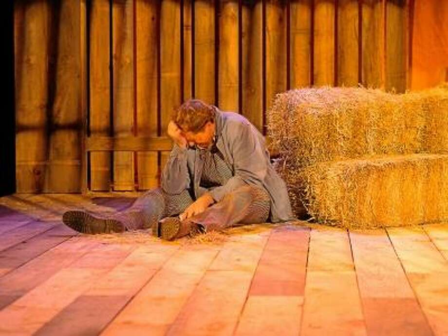 """Jed Aicher, who portrays Lennie Small in a Playhouse on Park production of Steinbeck's """"Of Mice and Men,"""" reacts during a rehearsal. / Imagine it Framed"""