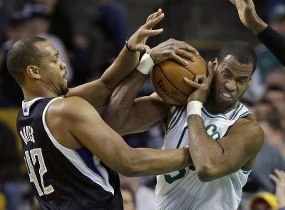 """FILE - In this Jan. 30, 2013, file photo, Boston Celtics center Jason Collins, right, struggles for control of the ball with Sacramento Kings forward Chuck Hayes (42) during the second half of an NBA basketball game in Boston. ESPN says that it regrets the """"distraction"""" caused by one of its reporters who described Jason Collins as a sinner after the NBA center publicly revealed that he was gay. Chris Broussard, who covers the NBA for ESPN, had said on the air that Collins and others in the NBA who engage in premarital sex or adultery were """"walking in open rebellion to God, and to Jesus Christ."""" (AP Photo/Elise Amendola, File) Photo: AP / AP"""