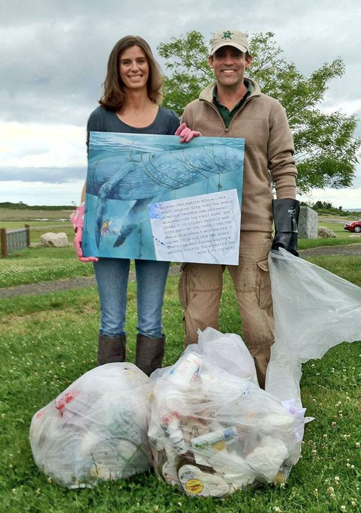 Anne Kubitsky and Ranger Russ Miller on the grounds of the Meigs Point Nature Center at Hammonasset Beach State Park for an environmental clean-up. Photo courtesy of Rebecca Williams