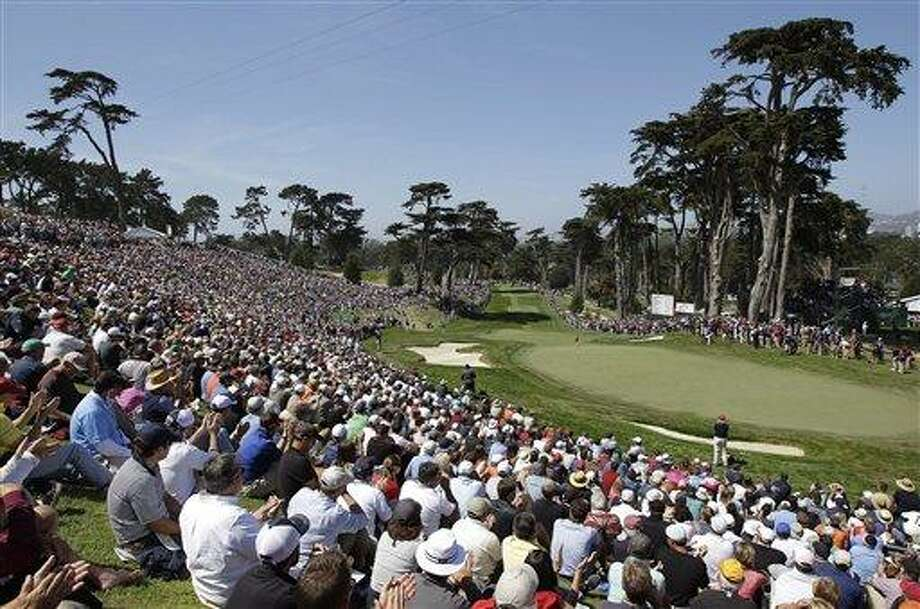 Fans wait for Tiger Woods, Phil Mickelson and Bubba Watson to hit to the eighth green during the second round of the U.S. Open Championship golf tournament Friday, June 15, 2012, at The Olympic Club in San Francisco. (AP Photo/Ben Margot) Photo: AP / AP