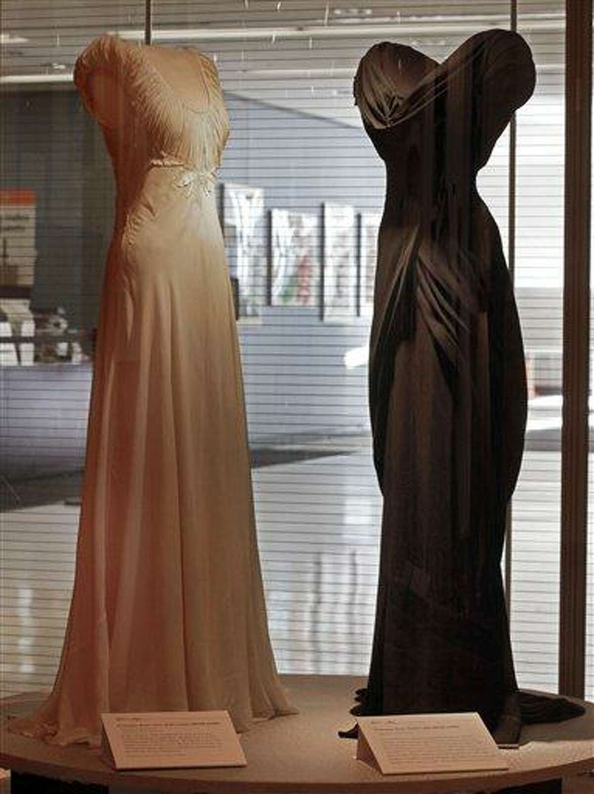 """A design by Irene, left, from the 1948 MGM movie """"State of the Union,"""" and one by Walter Plunkett from the 1949 MGM movie """"Adam's Rib,"""" are shown as part of the """"Katharine Hepburn: Dressed for Stage and Screen"""" exhibit in the New York Public Library for the Performing Arts at Lincoln Center. AP Photo"""