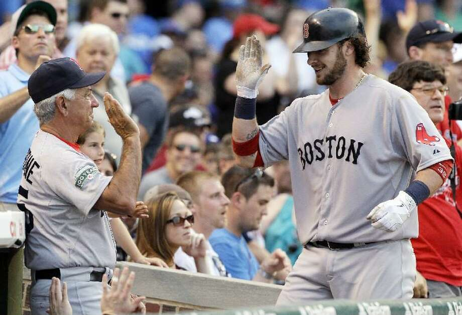 ASSOCIATED PRESS Boston Red Sox catcher Jarrod Saltalamacchia, right, celebrates with manager Bobby Valentine after hitting a two-run home run during the fourth inning of Saturday's game against the Chicago Cubs Saturday at Wrigley Field in Chicago.