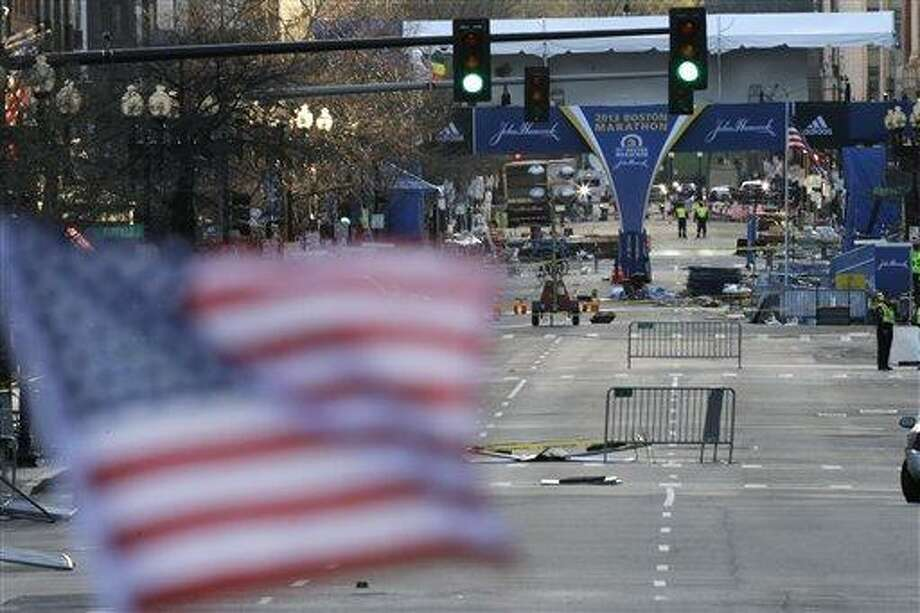 Shown is Boylston Street near the finish line of Monday's Boston Marathon explosions, which killed at least three and injured more than 140, Thursday, April 18, 2013, in Boston. (AP Photo/Matt Rourke). (AP Photo/Matt Rourke) Photo: AP / AP