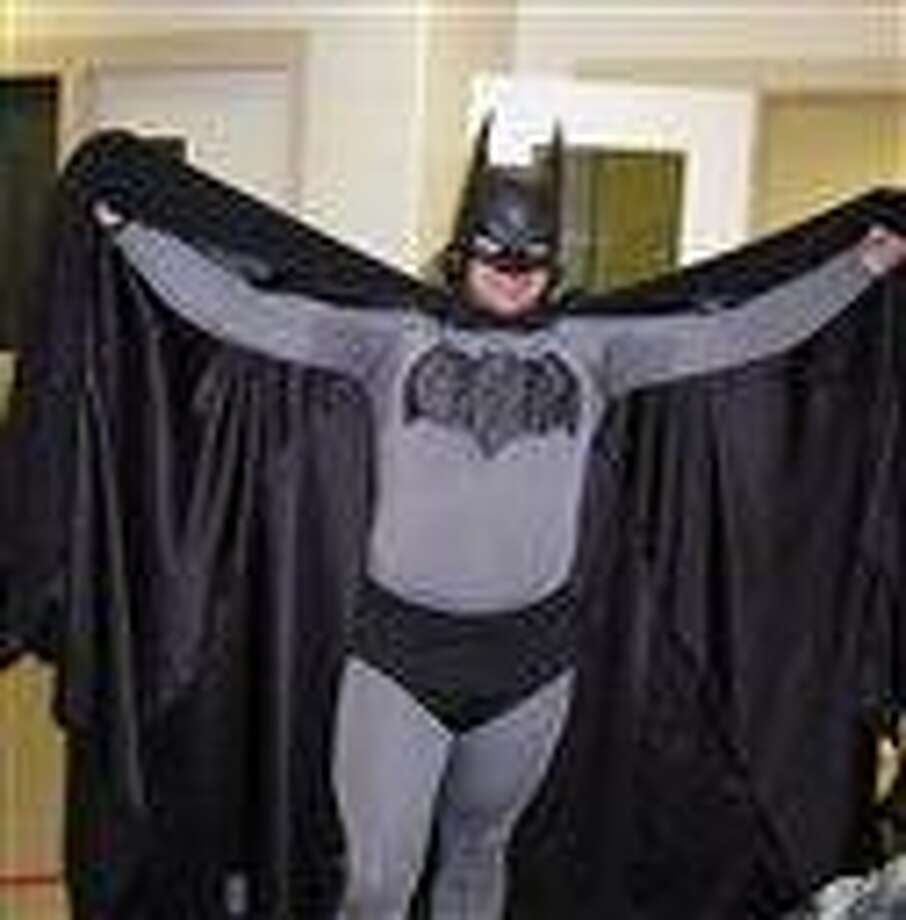 In this May 11, 2011 file photo provided by the Petoskey, Mich., Department of Public Safety shows Mark Williams dressed as Batman, at the Emmet County jail in Petoskey, Mich.  Michigan State Police arrested Williams, 33, in his Batman outfit, for resisting and obstructing police in an investigation Saturday, Sept. 29, 2012 at a personal injury accident. Willams wanted to help look for the driver, but his scent kept confusing a police dog in its search.  (AP Photo/Petoskey Department of Public Safety via Petoskey News-Review) Photo: AP / Petoskey Department of Public Safety via Petoskey News-Review