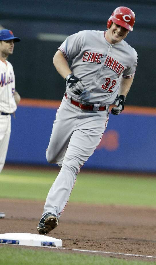 ASSOCIATED PRESS Cincinnati Reds' Jay Bruce (32) runs the bases after hitting a three-run home run during the first inning of Saturday's game against the New York Mets at Citi Field in New York. The Mets lost 4-1.